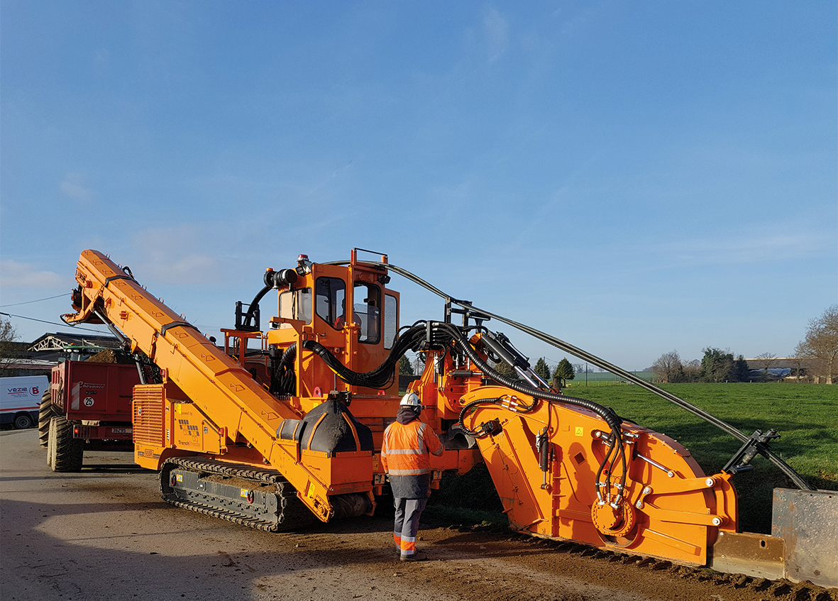 Tesmec 950R T620 works in close proximity to road shoulder